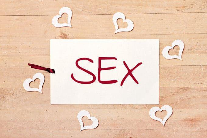 """photo: paper with the word """"Sex"""" written on it, surrounded by paper hearts"""
